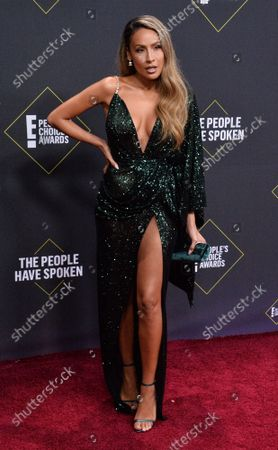 YouTuber Desi Perkins arrives for the 45th annual E! People's Choice Awards at the Barker Hangar in Santa Monica, California on Sunday, November 10, 2019.