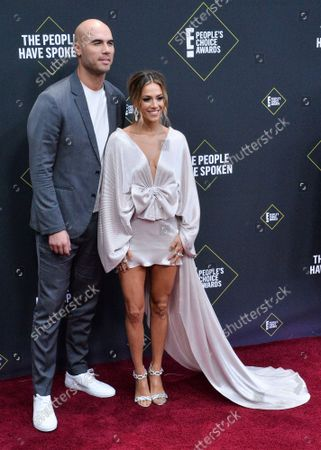Stock Picture of Mike Caussin and Jana Kramer arrive for the 45th annual E! People's Choice Awards at the Barker Hangar in Santa Monica, California on Sunday, November 10, 2019.