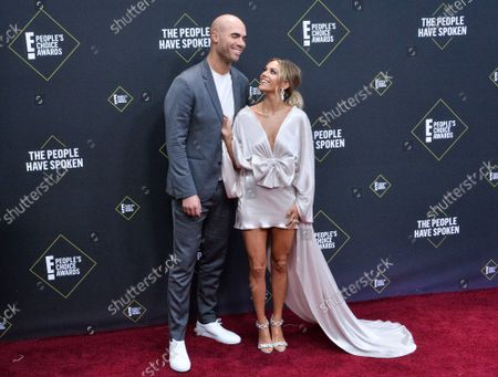 Mike Caussin and Jana Kramer arrive for the 45th annual E! People's Choice Awards at the Barker Hangar in Santa Monica, California on Sunday, November 10, 2019.