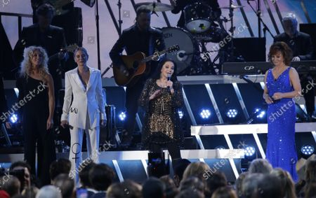 Kimberly Schlapman of Little Big Town, Jennifer Nettles, Crystal Gayle and Reba McEntire (L-R) perform at the 52nd Annual Country Music Association Awards at Bridgestone Arena in Nashville, Tennessee Wednesday, November 13, 2019.