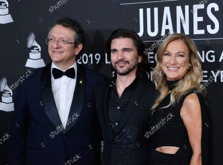 President & CEO of The Latin Academy of Recording Arts & Sciences Gabriel Abaroa, honoree Juanes, and President & CEO of The Recording Academy Deborah Dugan arrive for the Latin Grammy Person of the Year gala honoring Columbian singer Juanes at the MGM Grand Convention Center in Las Vegas, Nevada on Wednesday, November 13, 2019.