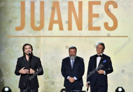 Stock Photo of (L-R) Juanes accepts his Person of the Year award from Chairman/CEO, Universal Music Latin America and Iberian Peninsula Jesus Lopez and President & CEO of Latin Academy of Recording Arts & Sciences Gabriel Abaroa onstage at the Latin Grammy Person of the Year gala honoring Columbian singer Juanes at the MGM Grand Convention Center in Las Vegas, Nevada on Wednesday, November 13, 2019.