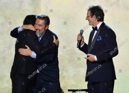 Stock Picture of (L-R) Juanes accepts his Person of the Year award from Chairman/CEO, Universal Music Latin America and Iberian Peninsula Jesus Lopez and President & CEO of Latin Academy of Recording Arts & Sciences Gabriel Abaroa onstage at the Latin Grammy Person of the Year gala honoring Columbian singer Juanes at the MGM Grand Convention Center in Las Vegas, Nevada on Wednesday, November 13, 2019.