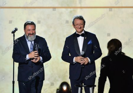 Juanes (R) accepts his Person of the Year award from Chairman/CEO, Universal Music Latin America and Iberian Peninsula Jesus Lopez (L) and President & CEO of Latin Academy of Recording Arts & Sciences Gabriel Abaroa (C) onstage at the Latin Grammy Person of the Year gala honoring Columbian singer Juanes at the MGM Grand Convention Center in Las Vegas, Nevada on Wednesday, November 13, 2019.