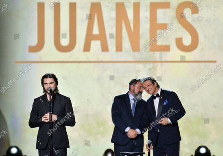 (L-R) Juanes accepts his Person of the Year award from Chairman/CEO, Universal Music Latin America and Iberian Peninsula Jesus Lopez and President & CEO of Latin Academy of Recording Arts & Sciences Gabriel Abaroa onstage at the Latin Grammy Person of the Year gala honoring Columbian singer Juanes at the MGM Grand Convention Center in Las Vegas, Nevada on Wednesday, November 13, 2019.
