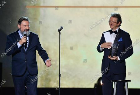Stock Image of (L-R) Chairman/CEO, Universal Music Latin America and Iberian Peninsula Jesus Lopez and President & CEO of Latin Academy of Recording Arts & Sciences Gabriel Abaroa onstage at the Latin Grammy Person of the Year gala honoring Columbian singer Juanes at the MGM Grand Convention Center in Las Vegas, Nevada on Wednesday, November 13, 2019.