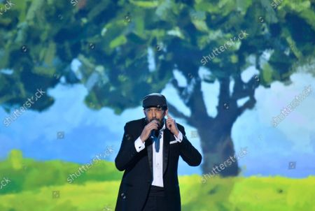 """Musician Juan Luis Guerra performs """"A Dios Le Pido"""" onstage at the Latin Grammy Person of the Year gala honoring Columbian singer Juanes at the MGM Grand Convention Center in Las Vegas, Nevada on Wednesday, November 13, 2019."""