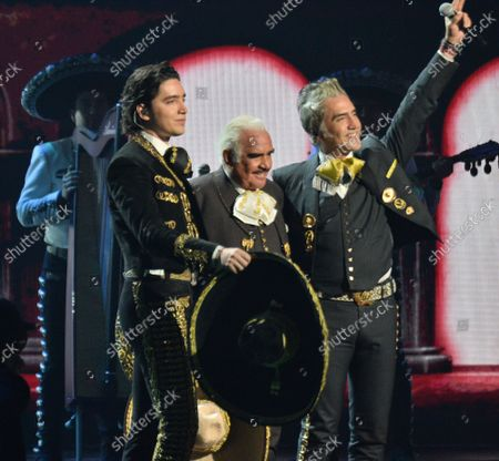 """(L-R)  Alex Fernandez, Jr., Vicente Fernandez and Alejando Fernandez perform a medley of """"Te Amare, Caballero, Derrota & Volver Volver onstage during the 20th annual Latin Grammy Awards honoring Columbian singer Juanes at the MGM Grand Convention Center in Las Vegas, Nevada on Thursday, November 14, 2019."""