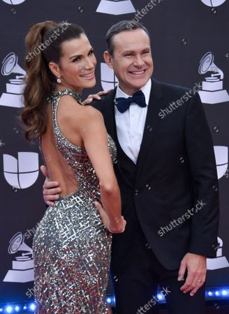 (L-R) Actress Cristina Bernal and TV personality Alan Tacher arrive on the red carpet for the 20th annual Latin Grammy Awards honoring Columbian singer Juanes at the MGM Grand Convention Center in Las Vegas, Nevada on Thursday, November 14, 2019.