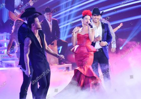 """Prince Royce (L), Natalia Jimenez (C) and Calibre 50 perform """"Secreto de Amor""""onstage during the 20th annual Latin Grammy Awards honoring Columbian singer Juanes at the MGM Grand Convention Center in Las Vegas, Nevada on Thursday, November 14, 2019."""