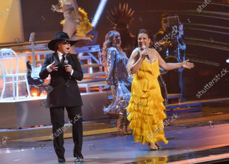 """Stock Picture of (L-R) Olga Tanon and Milly Quezada perform """"La Vida es un Carnaval"""" onstage during the 20th annual Latin Grammy Awards honoring Columbian singer Juanes at the MGM Grand Convention Center in Las Vegas, Nevada on Thursday, November 14, 2019."""