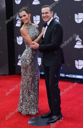 Stock Photo of (L-R) Actress Cristina Bernal and TV personality Alan Tacher arrive on the red carpet for the 20th annual Latin Grammy Awards honoring Columbian singer Juanes at the MGM Grand Convention Center in Las Vegas, Nevada on Thursday, November 14, 2019.