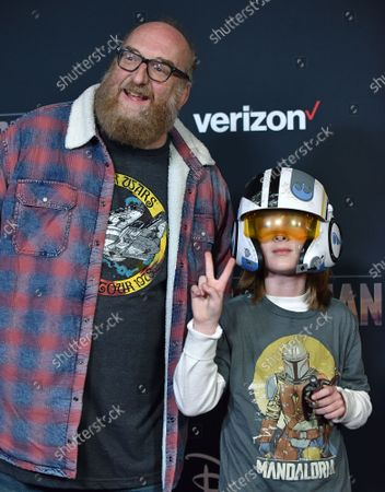 Brian Posehn (L) arrives for the premiere of Disney+'s 'The Mandalorian' at the El Capitan Theatre in Los Angeles, California on Wednesday, November 13, 2019.