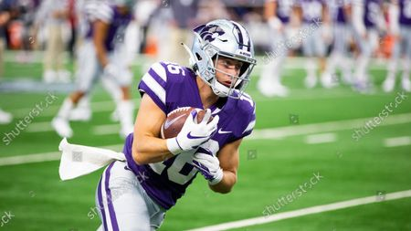 Stock Photo of Kansas State wide receiver Seth Porter (16) carries the ball during warm ups before an NCAA football game against Stanford, in Arlington, Texas