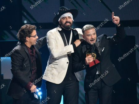 (L-R) George Noriega, Gabriel Edgar González Pérez and Pedro Capo accept their Song of the Year award during the 20th annual Latin Grammy Awards honoring Columbian singer Juanes at the MGM Grand Convention Center in Las Vegas, Nevada on Thursday, November 14, 2019.