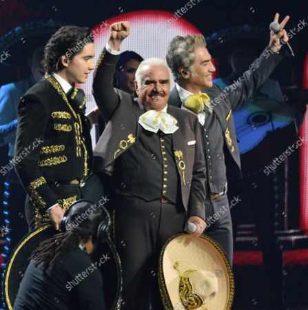 """(L-R) Alex Fernandez, Jr. , Vicente Fernandez and Alejandro Fernandez perform a medley of """"Te Amare, Caballero, Derrota & Volver Volver"""" during the 20th annual Latin Grammy Awards honoring Columbian singer Juanes at the MGM Grand Convention Center in Las Vegas, Nevada on Thursday, November 14, 2019."""