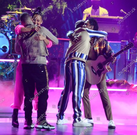"""(L-R) Farruko, Alicia Keys and Pedro Capo perform a medley of """"Show Me Love & Calma"""" during the 20th annual Latin Grammy Awards honoring Columbian singer Juanes at the MGM Grand Convention Center in Las Vegas, Nevada on Thursday, November 14, 2019."""