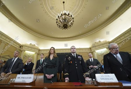 State Department official and advisor to Vice President Mike Pence Jennifer Williams and Lt. Col. Alexander Vindman, an expert on Eastern European affairs on the National Security Council, prepare to testify before the House Permanent Select Committee on Intelligence as part of the impeachment inquiry into President Donald Trump, on Capitol Hill in Washington, DC, on Tuesday, November 19, 2019.  The hearings are looking into whether Trump used military aid as leverage to pressure Ukraine into investigations that would benefit him politically.