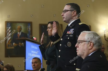 State Department official and advisor to Vice President Mike Pence Jennifer Williams and Lt. Col. Alexander Vindman, an expert on Eastern European affairs on the National Security Council, are sworn in before the House Permanent Select Committee on Intelligence as part of the impeachment inquiry into President Donald Trump, on Capitol Hill in Washington, DC, on Tuesday, November 19, 2019.  The hearings are looking into whether Trump used military aid as leverage to pressure Ukraine into investigations that would benefit him politically.