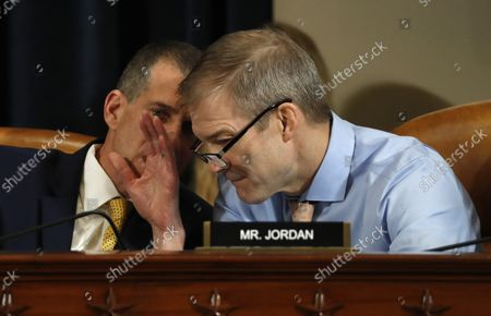 Rep. Jim Jordan, R-Ohio,, right talks with Steve Castor, the Republican staff attorney, as Jennifer Williams, an aide to Vice President Mike Pence, and National Security Council aide Lt. Col. Alexander Vindman, testify before the House Intelligence Committee on Capitol Hill in Washington, Tuesday, Nov. 19, 2019, during a public impeachment hearing of President Donald Trump's efforts to tie U.S. aid for Ukraine to investigations of his political opponents.
