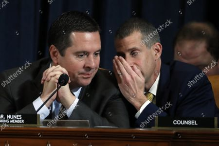 Steve Castor, the Republican staff attorney, right, talk with ranking member Rep. Devin Nunes of Calif., as Jennifer Williams, an aide to Vice President Mike Pence, and National Security Council aide Lt. Col. Alexander Vindman, testify before the House Intelligence Committee on Capitol Hill in Washington, Tuesday, Nov. 19, 2019, during a public impeachment hearing of President Donald Trump's efforts to tie U.S. aid for Ukraine to investigations of his political opponents.