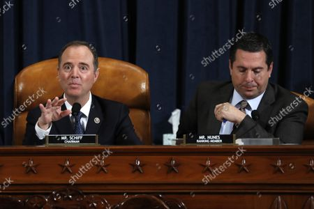 House Intelligence Committee Chairman Adam Schiff, D-Calif., left, and ranking member Rep. Devin Nunes of Calif., speak as Jennifer Williams, an aide to Vice President Mike Pence, and National Security Council aide Lt. Col. Alexander Vindman, testify before the House Intelligence Committee on Capitol Hill in Washington, Tuesday, Nov. 19, 2019, during a public impeachment hearing of President Donald Trump's efforts to tie U.S. aid for Ukraine to investigations of his political opponents.