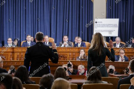 Jennifer Williams, an aide to Vice President Mike Pence, and National Security Council aide Lt. Col. Alexander Vindman, left, are sworn in to testify before the House Intelligence Committee on Capitol Hill in Washington, Tuesday, Nov. 19, 2019, during a public impeachment hearing of President Donald Trump's efforts to tie U.S. aid for Ukraine to investigations of his political opponents.