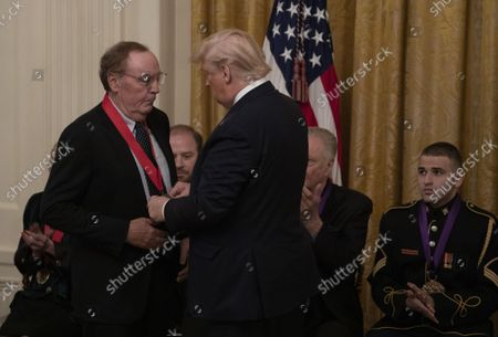 James Patterson receives National Humanities Medal from President Donald Trump at the White House in Washington, D.C.on Thursday, November 21, 2019.