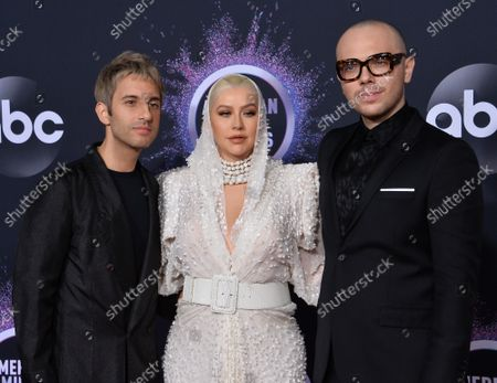 Stock Image of Chad King (L), Ian Axel (R) of A Great Big World and singer Christina Aguilera (C) arrive for the 47th annual American Music Awards at the Microsoft Theater in Los Angeles on Sunday, November 24, 2019.
