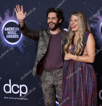 (L-R) Singer Thomas Rhett and Lauren Akins arrive for the 47th annual American Music Awards at the Microsoft Theater in Los Angeles on Sunday, November 24, 2019.