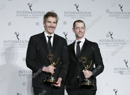 David Benioff and D.B. Weiss stand with Emmy Awards at the 47th International Emmy Awards at the New York Hilton in New York City on November 25, 2019.