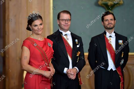 Sweden's Crown Princess Victoria, Prince Daniel and Prince Carl Philip arrive for a State Banquet at the Royal Palace in Stockholm, Sweden, on Sept. 07 2021. The German presidential couple arrived in Sweden on Tuesday for a three-day state visit.,
