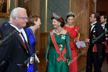(L-R) Sweden' King Carl Gustaf, Elke Büdenbender, wife of German President Frank-Walter Steinmeier, Sweden's Queen Silvia, Crown Princess Victoria, Prince Daniel and Prince Carl Philip arrive for a State Banquet at the Royal Palace in Stockholm, Sweden, on Sept. 07 2021. The German presidential couple arrived in Sweden on Tuesday for a three-day state visit.,