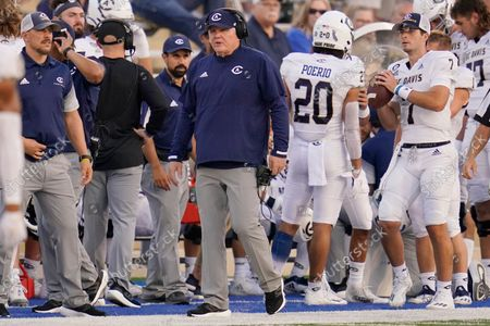 Stock Picture of Davis head coach Dan Hawkins walks on the sidelines, during an NCAA college football game against Tulsa, in Tulsa, Okla