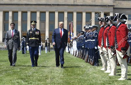 President Donald Trump (R) reviews troops with the new Secretary of Defense Mark Esper (L) and Vice Chairman of the Joint Chiefs of Staff Gen. Paul Selva, at the Pentagon, on July 25, 2019, Washington, D.C. The Department of Defense has been without a full-time leader since former Secretary Jim Mattis resigned in December 2018.