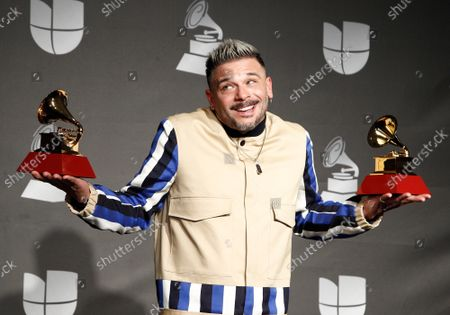 """Pedro Capo appears backstage with the awards for best urban fusion/performance for """"Calma (Remix)"""" and song of the year for """"Calma"""" during the 20th annual Latin Grammy Awards at the MGM Garden Arena in Las Vegas, Nevada on Thursday, November 14, 2019."""