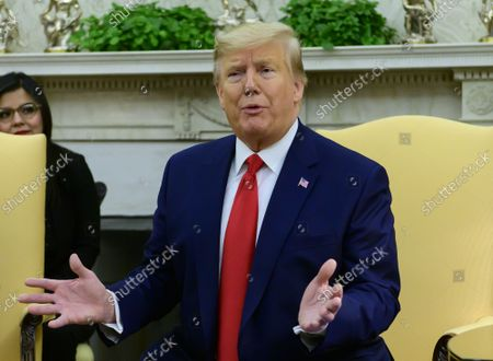 United States President Donald J. Trump speaks to the media as he and First lady Melania Trump welcome President Jimmy Morales and Mrs. Hilda Patricia Marroquín Argueta de Morales of the Republic of Guatemala to the Oval Office of the White House in Washington, DC on Tuesday, December 17, 2019.