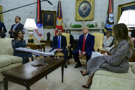 United States President Donald J. Trump and First lady Melania Trump welcome President Jimmy Morales and Mrs. Hilda Patricia Marroquín Argueta de Morales of the Republic of Guatemala to the Oval Office of the White House in Washington, DC on Tuesday, December 17, 2019.