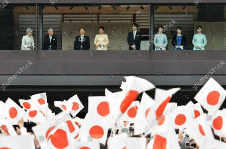 (L-R)Japan's Empress Emerita Michiko, Emperor Emeritus Akihito, Emperor Naruhito, Empress Masako, Crown Prince Akishino, Crown Princess Kiko, Princess Mako and Princess Kako wave to well-wishers during a new year greeting at the East Plaza, Imperial Palace in Tokyo, Japan, on Thursday, January 2, 2020. Japan's Emperor Naruhito delivered his first new year's address on his enthronement last year, expressing his sympathy to survivors of recent natural disasters and hope will be a peaceful year without any disaster and for the happiness for the people in Japan and around the world.
