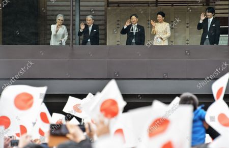 (L-R)Japan's Empress Emerita Michiko, Emperor Emeritus Akihito, Emperor Naruhito, Empress Masako and Crown Prince Akishino wave to well-wishers during a new year greeting at the East Plaza, Imperial Palace in Tokyo, Japan, on Thursday, January 2, 2020. Japan's Emperor Naruhito delivered his first new year's address on his enthronement last year, expressing his sympathy to survivors of recent natural disasters and hope will be a peaceful year without any disaster and for the happiness for the people in Japan and around the world.