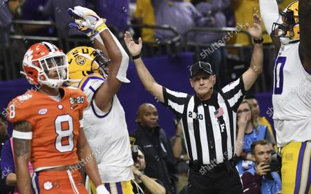 LSU's Ja'Marr Chase celebrates with teammate Steven Sullivan after scoring a touchdown as Clemson's A.J. Terrell walks past during the second quarter of the college national championship game at the Superdome in New Orleans, Louisiana on Monday, January 13, 2020.