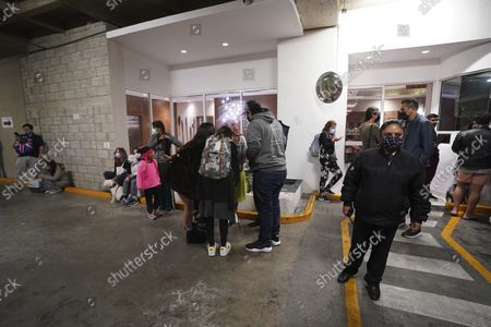 People gather outside a building after a strong earthquake, in Mexico City, . The quake struck southern Mexico near the resort of Acapulco, causing buildings to rock and sway in Mexico City nearly 200 miles away