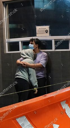 Couple embraces outside a building after a strong earthquake, in Mexico City, . The quake struck southern Mexico near the resort of Acapulco, causing buildings to rock and sway in Mexico City nearly 200 miles away