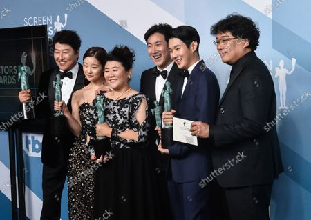 (L-R) Song Kang-ho, Cho Yeo-jeong, director Bong Joon-ho, Lee Jung-eun, Choi Woo-shik, and Lee Sun-kyun appear backstage with the award for Outstanding Performance by a Cast in a Motion Picture for 'Parasite', during the 26th annual SAG Awards held at the Shrine Auditorium in Los Angeles on Sunday, January 19, 2020. The Screen Actors Guild Awards will be broadcast live on TNT and TBS.