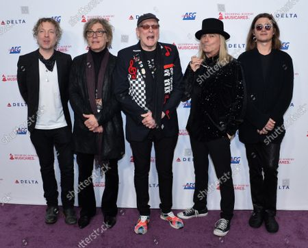 (L-R) Daxx Nielsen, Tom Petersson, Rick Nielsen, Robin Zander and Robin Taylor Zander Jr. of US rock band Cheap Trick arrive for the MusiCares Person of the Year gala honoring Aerosmith at the Los Angeles Convention Center in Los Angeles on Friday, January 24, 2020.