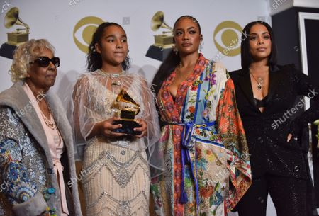 Stock Picture of (L-R) Nipsey Hussle's grandmother Margaret Bouffe, Nipsey Hussle's daughter Emani Asghedom, Nipsey Hussle's sister Samantha Smith, and Nipsey Hussle's wife Lauren London appear backstage during the 62nd annual Grammy Awards held at Staples Center in Los Angeles on Sunday, January 26, 2020 .