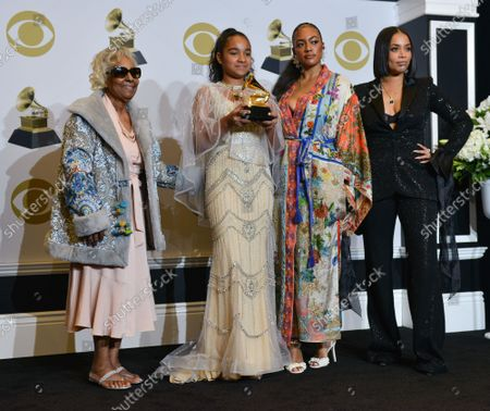 (L-R) Nipsey Hussle's grandmother Margaret Bouffe, Nipsey Hussle's daughter Emani Asghedom, Nipsey Hussle's sister Samantha Smith, and Nipsey Hussle's wife Lauren London appear backstage during the 62nd annual Grammy Awards held at Staples Center in Los Angeles on Sunday, January 26, 2020 .