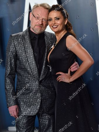 Jared Harris (L) and Allegra Riggio arrive for the Vanity Fair Oscar party at the Wallis Annenberg Center for the Performing Arts in Beverly Hills, California on February 9, 2020.