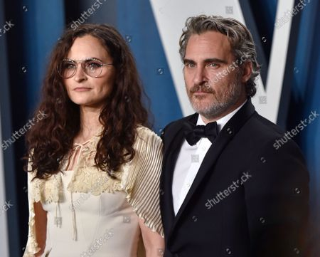 Joaquin Phoenix (R) and his sister Rain Phoenix arrive for the Vanity Fair Oscar party at the Wallis Annenberg Center for the Performing Arts in Beverly Hills, California on February 9, 2020.