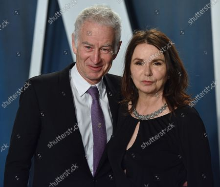 John McEnroe and Patty Smyth arrive for the Vanity Fair Oscar party at the Wallis Annenberg Center for the Performing Arts in Beverly Hills, California on February 9, 2020.